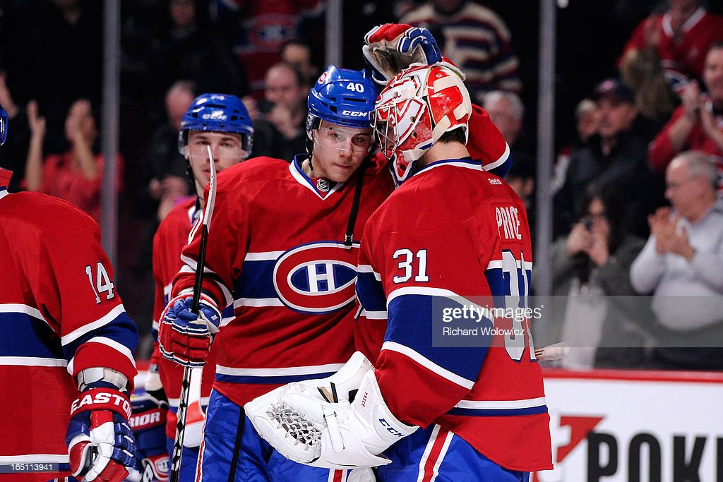 Nathan Beaulieu #40 and <a gi-track='captionPersonalityLinkClicked' href=/galleries/search?phrase=Carey+Price&family=editorial&specificpeople=2222083 ng-click='$event.stopPropagation()'>Carey Price</a> #31 of the Montreal Canadiens celebrate after defeating the New York Rangers in their NHL game at the Bell Centre on March 30, 2013 in Montreal, Quebec, Canada. The Canadiens defeated the Rangers 3-0.