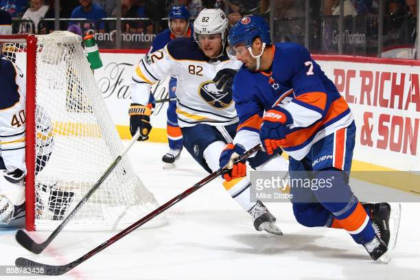 Nathan Beaulieu of the Columbus Blue Jackets battles for the puck agaist Jordan Eberle of the New York Islanders during the game at Barclays Center...