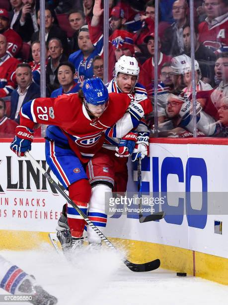 Nathan Beaulieu of the Montreal Canadiens and Jesper Fast of the New York Rangers battle for the puck along the boards in Game Five of the Eastern...