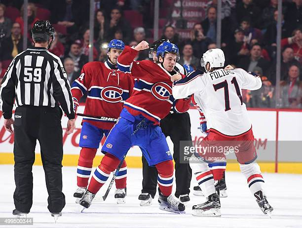 Nathan Beaulieu of the Montreal Canadiens and Nick Foligno of the Columbus Blue Jackets fight in the second period in the NHL game at the Bell Centre...