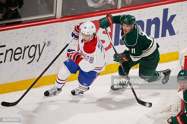 Nathan Beaulieu of the Montreal Canadiens and Zach Parise of the Minnesota Wild skate to the puck during the game on December 22 2015 at the Xcel...
