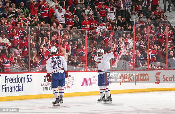 Nathan Beaulieu of the Montreal Canadiens celebrates his first career NHL goal with teammate PK Subban in a game against the Ottawa Senators at...