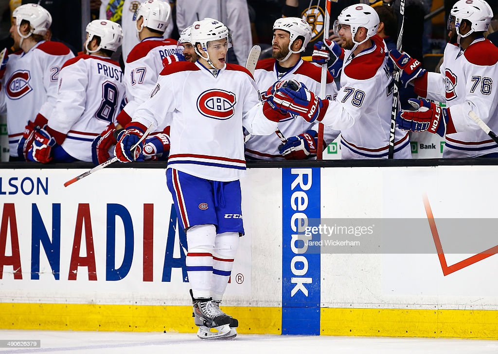 Nathan Beaulieu #40 of the Montreal Canadiens celebrates with teammates against the Boston Bruins during Game Seven of the Second Round of the 2014 NHL Stanley Cup Playoffs at the TD Garden on May 14, 2014 in Boston, Massachusetts.