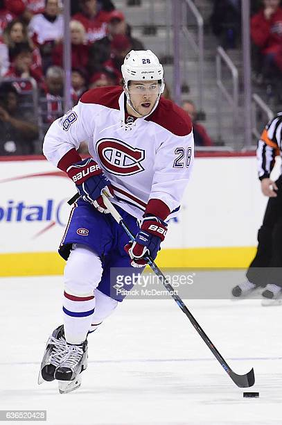 Nathan Beaulieu of the Montreal Canadiens controls the puck against the Washington Capitals in the second period during a NHL game at Verizon Center...