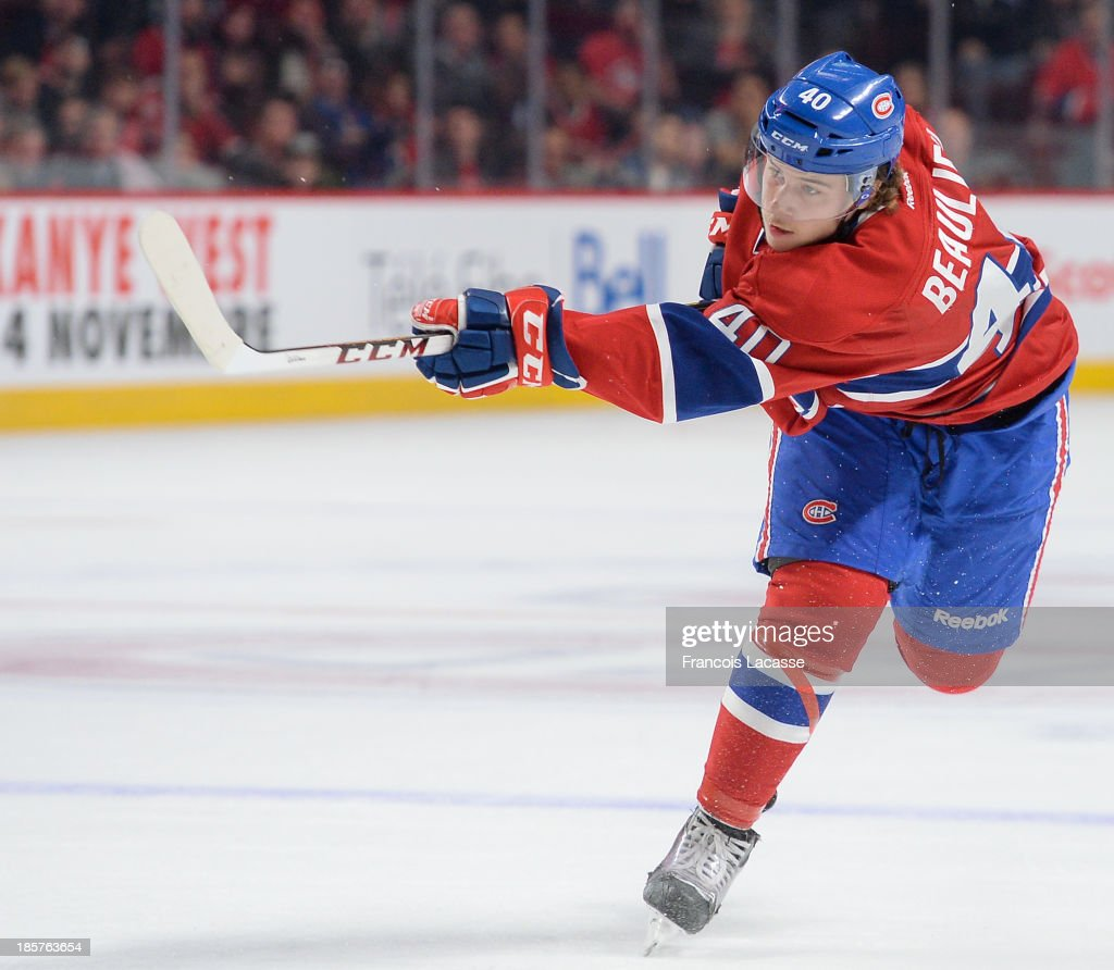 <a gi-track='captionPersonalityLinkClicked' href=/galleries/search?phrase=Nathan+Beaulieu&family=editorial&specificpeople=6555395 ng-click='$event.stopPropagation()'>Nathan Beaulieu</a> #40 of the Montreal Canadiens fires a slap shot against against the Anaheim Ducks during the NHL game on October 24, 2013 at the Bell Centre in Montreal, Quebec, Canada.