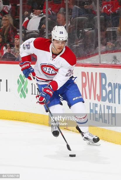 Nathan Beaulieu of the Montreal Canadiens plays the puck against the New Jersey Devils during the game at Prudential Center on February 27 2017 in...
