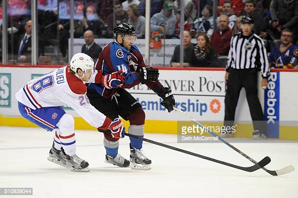 Nathan Beaulieu of the Montreal Canadiens poke checks the puck away from Blake Comeau of the Colorado Avalanche during the third period at the Pepsi...