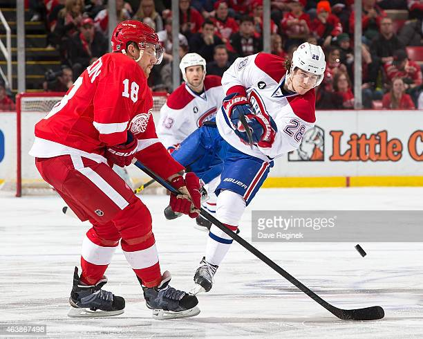 Nathan Beaulieu of the Montreal Canadiens shoot the puck past Joakim Andersson of the Detroit Red Wings during a NHL game on February 16 2015 at Joe...
