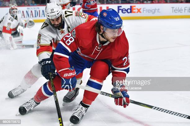 Nathan Beaulieu of the Montreal Canadiens skates against Derek Mackenzie of the Florida Panthers in the NHL game at the Bell Centre on March 30 2017...