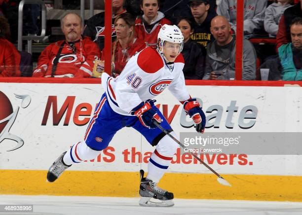 Nathan Beaulieu of the Montreal Canadiens skates for position along the boards during their NHL game against the Carolina Hurricanes at PNC Arena on...