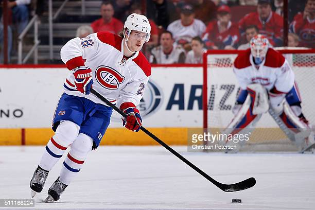 Nathan Beaulieu of the Montreal Canadiens skates with the puck during the NHL game against the Arizona Coyotes at Gila River Arena on February 15...