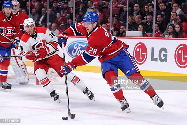 Nathan Beaulieu of the Montreal Canadiens skates with the puck in front of Patrick Dwyer of the Carolina Hurricanes during the NHL game at the Bell...