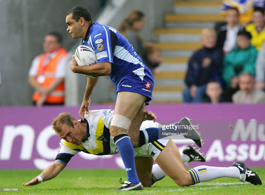 Nathan Blacklock of Hull brushes aside Warrington's Paul Noone during the Engage Super League Second Elimination playoff match between Warrington...