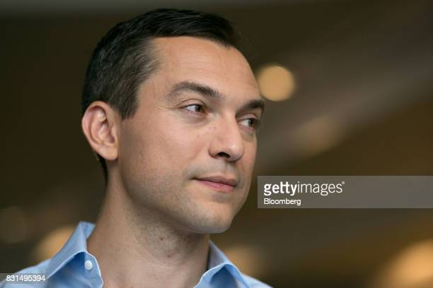 Nathan Blecharczyk cofounder and chief technology officer of Airbnb Inc listens during a Bloomberg Television interview in Singapore on Tuesday Aug...
