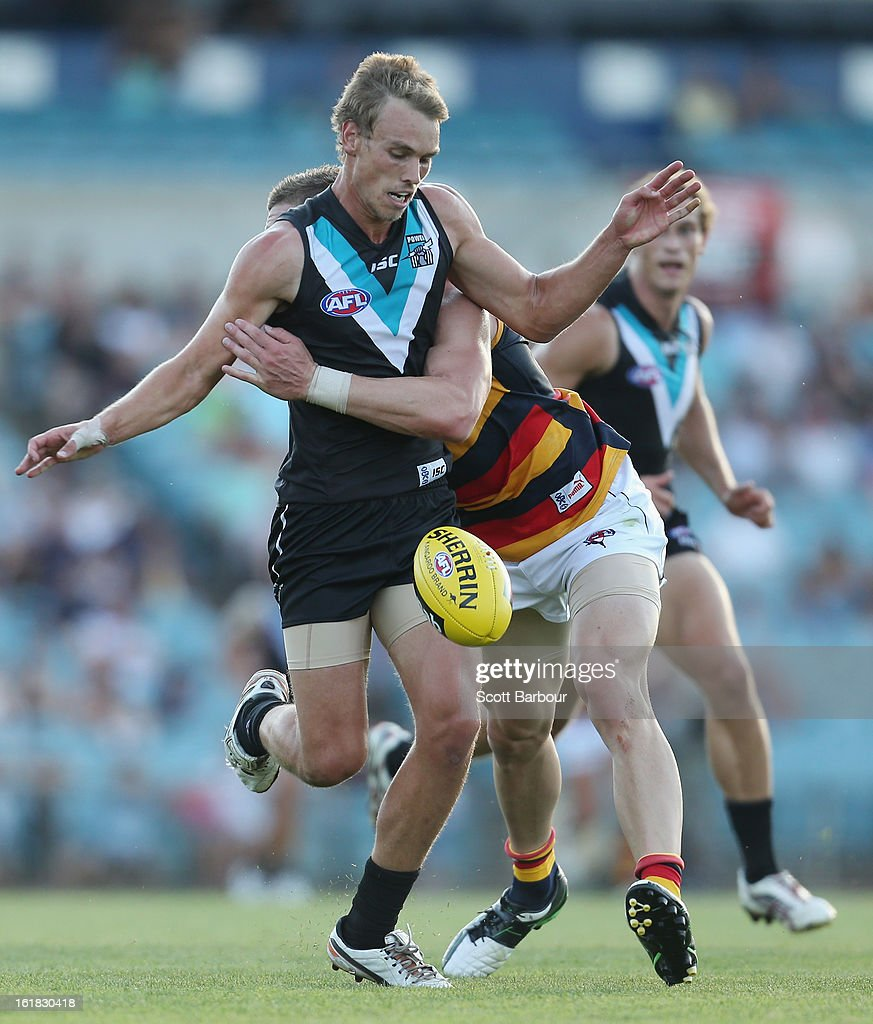Nathan Blee of the Power is tackled during the round one AFL NAB Cup match between the Adelaide Crows and the Port Adelaide Power at AAMI Stadium on February 17, 2013 in Adelaide, Australia.