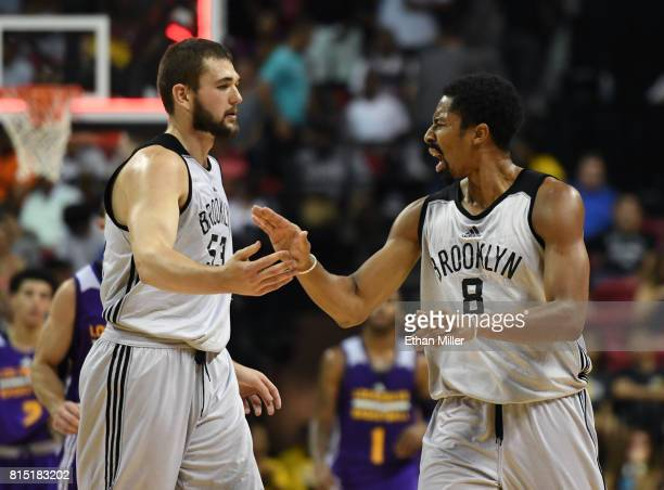 Nathan Boothe of the Brooklyn Nets congratulates teammate Spencer Dinwiddie after he hit a shot against the Los Angeles Lakers at the end of the...