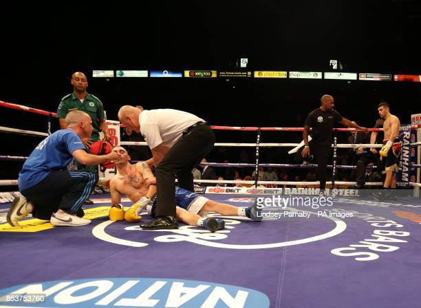 Nathan Brough receives medical attention after being knockedout by Jack Catterall in the vacant Central Area Light Welterweight Championship during...