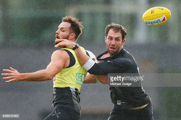 Nathan Brown and Travis Cloke compete for the ball during a Collingwood Magpies AFL media opportunity at the Glasshouse Theatre on June 9 2016 in...
