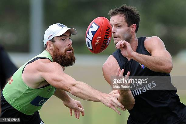 Nathan Brown handballs in the tackle of Ben Hudson during a Collingwood Magpies AFL training session at the Southport Football Club on February 26...