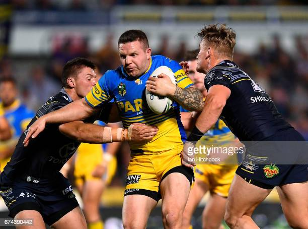 Nathan Brown of the Eels is tackled by Coen Hess of the Cowboys during the round nine NRL match between the North Queensland Cowboys and the...