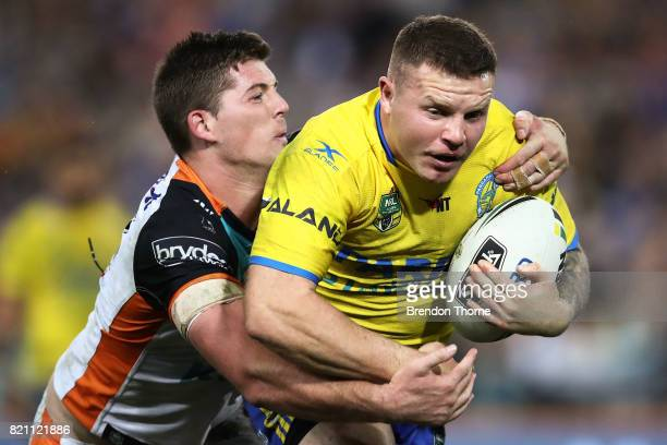 Nathan Brown of the Eels is tackled by the Tigers defence during the round 20 NRL match between the Wests Tigers and the Parramatta Eels at ANZ...