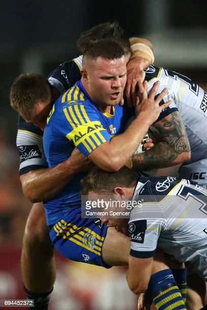 Nathan Brown of the Eels is tackled during the round 14 NRL match between the Parramatta Eels and the North Queensland Cowboys at TIO Stadium on June...