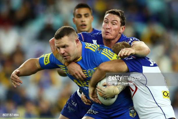 Nathan Brown of the Eels is tackled during the round 17 NRL match between the Parramatta Eels and the Canterbury Bulldogs at ANZ Stadium on June 29...