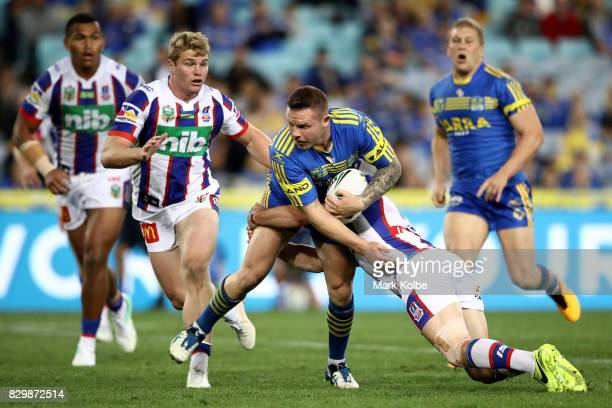 Nathan Brown of the Eels is tackled during the round 23 NRL match between the Parramatta Eels and the Newcastle Knights at ANZ Stadium on August 11...