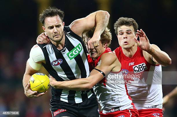 Nathan Brown of the Magpies is tackled by Brandon Jack of the Swans during the round 20 AFL match between the Sydney Swans and the Collingwood...