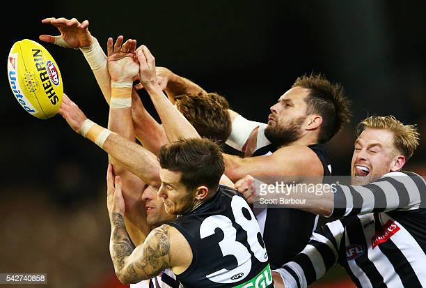 Nathan Brown of the Magpies Jeremy Howe of the Magpies and Jonathon Marsh of the Magpies compete for the ball with Matthew Pavlich of the Dockers...