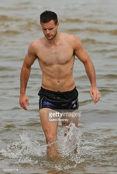 Nathan Brown of the Magpies walks out of the water during a Collingwod Magpies AFL recovery sessionat the St Kilda Sea Baths on September 18 2012 in...