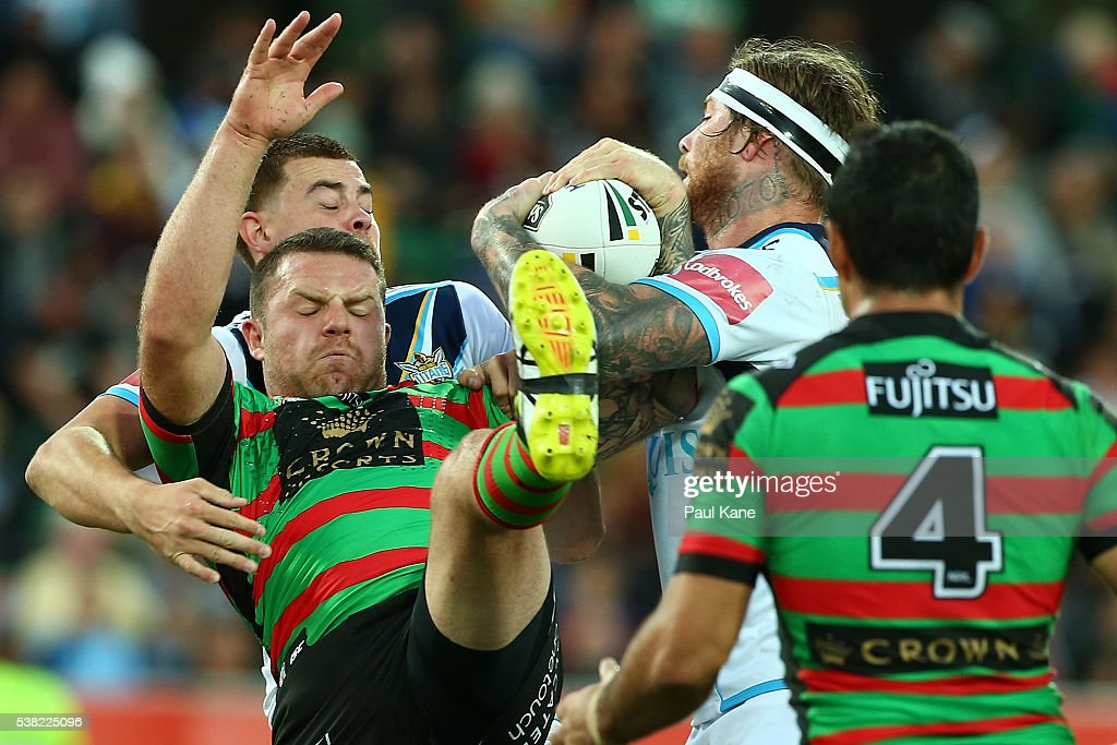 Nathan Brown of the Rabbitohs and Chris McQueen of the Titans contest for the ball during the round 13 NRL match between the South Sydney Rabbitohs and the Gold Coast Titans at nib Stadium on June 5, 2016 in Perth, Australia.