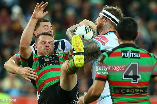 Nathan Brown of the Rabbitohs and Chris McQueen of the Titans contest for the ball during the round 13 NRL match between the South Sydney Rabbitohs...