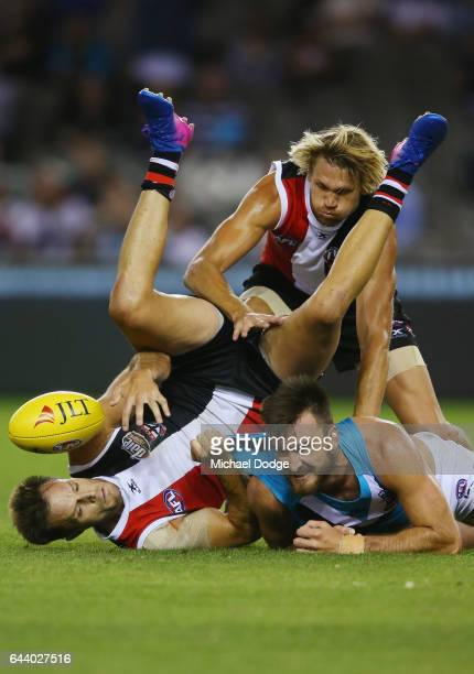 Nathan Brown of the Saints and Sam Gilbert of the Saints compete for the ball against Charlie Dixon of the Power during the JLT Community Series AFL...