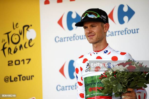 Nathan Brown of United States riding for Canondale Drapac in the king of the mountains jersey poses for a photo on the podium after stage three of...