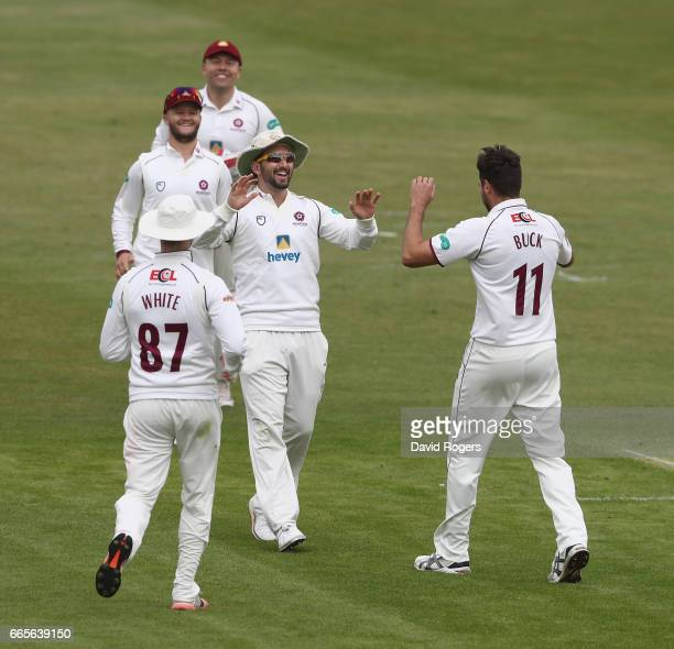 Nathan Buck of Northamptonshire celebrates with team mates aftertaking the wicket of Chris Cooke during the Specsavers County Championship division...
