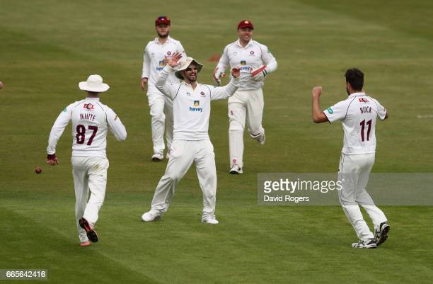 Nathan Buck of Northamptonshire celebrates with team mates aftertaking the wicket of Kiran Carlson during the Specsavers County Championship division...