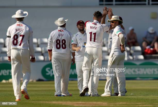 Nathan Buck of Northamptonshire celebrates with team mates the wicket of Brett D'Oliveria of Worcestershire during the Specsavers County Championship...