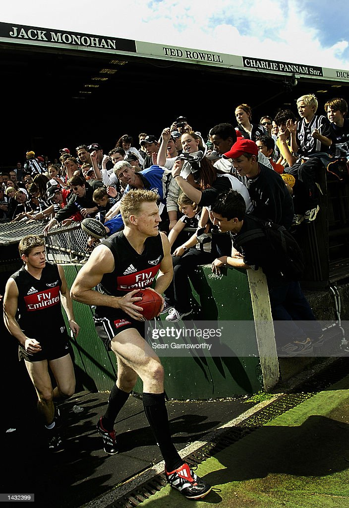 Nathan Buckley and Jason Cloke for Collingwood enter the field for Collingwoods last training session before the AFL Grand Final at Victoria Park in...