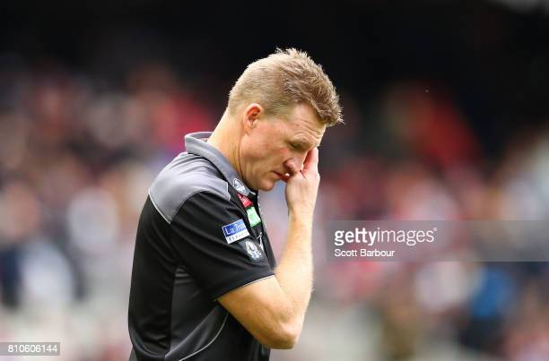 Nathan Buckley coach of the Magpies reacts as he speaks to his team during a quarter time break during the round 16 AFL match between the Collingwood...