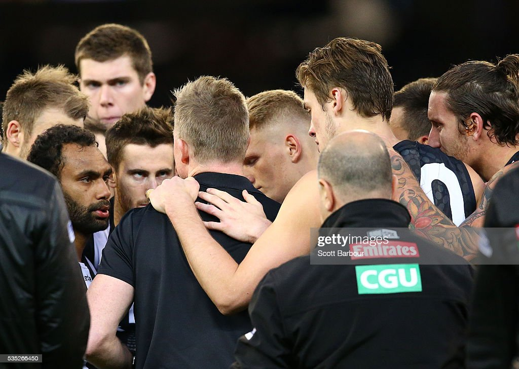 <a gi-track='captionPersonalityLinkClicked' href=/galleries/search?phrase=Nathan+Buckley&family=editorial&specificpeople=176545 ng-click='$event.stopPropagation()'>Nathan Buckley</a>, coach of the Magpies speaks to his team during a quarter time break during the round 10 AFL match between the Collingwood Magpies and the Western Bulldogs at Melbourne Cricket Ground on May 29, 2016 in Melbourne, Australia.