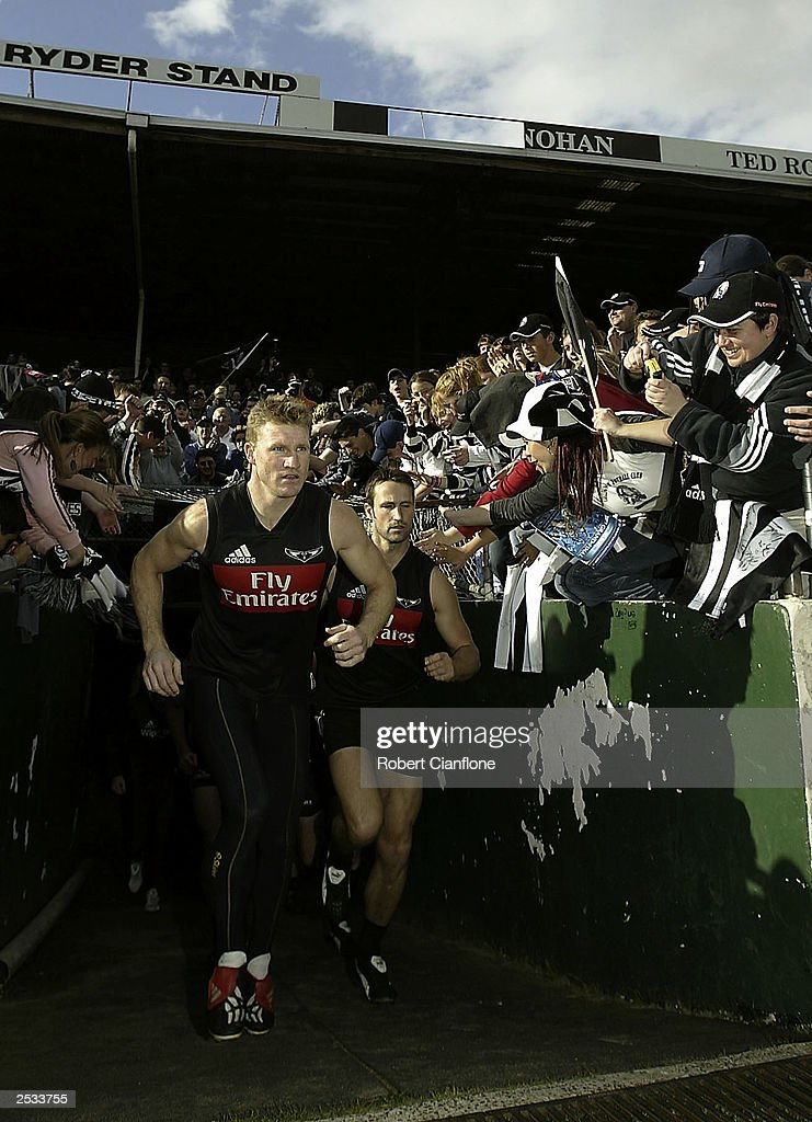 Nathan Buckley of the Magpies leads his team out during the Collingwood Magpies final training session held at Victoria Park September 25 2003 in...
