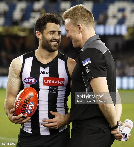 Nathan Buckley Senior Coach of the Magpies celebrates with Alex Fasolo of the Magpies during the 2017 AFL round 18 match between the Collingwood...
