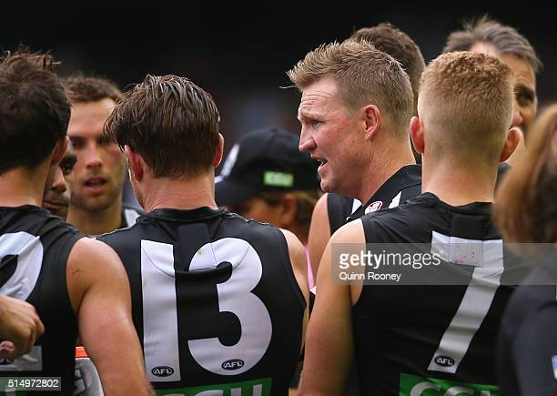 Nathan Buckley the coach of the Magpies talks to his players during the 2016 NAB Challenge AFL match between the Collingwood Magpies and the Western...