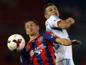 Nathan Burns of the Jets contests the ball with Kosta Barbarouses of the Victory during the round 14 ALeague match between the Newcastle Jets and...