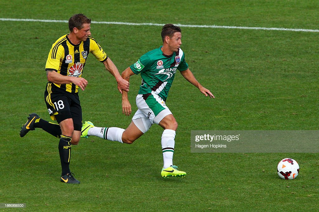 Nathan Burns of the Jets holds off the challenge of Ben Sigmund of the Phoenix during the round three A-League match between Wellington Phoenix and the Newcastle Jets at McLean Park on October 27, 2013 in Napier, New Zealand.