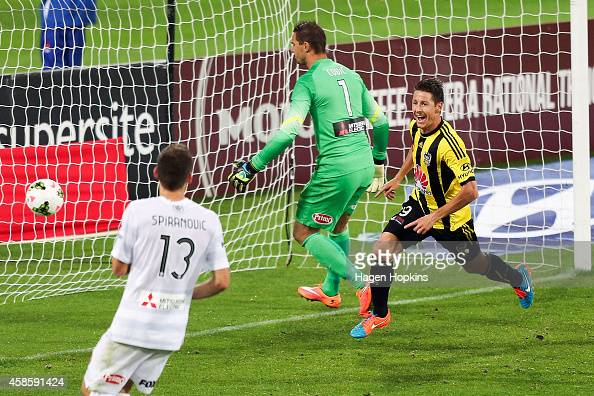 Nathan Burns of the Phoenix celebrates after scoring a goal past Ante Covic of the Wanderers during the round five ALeague match between the...