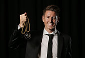 Nathan Burns of Wellington Phoenix poses with the Johnny Warren Medal as the Hyundai ALeague Players Player of the Year during the ALeague WLeague...
