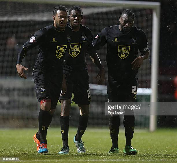 Nathan Cameron and Tom Soares of Bury walk with team mate Hayden White as he leaves the pitch after being shown a red card during the Sky Bet League...