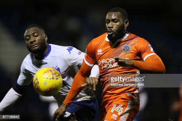 Nathan Cameron of Bury and Lenell JohnLewis of Shrewsbury Town during the Sky Bet League One match between Bury and Shrewsbury Town at Gigg Lane on...